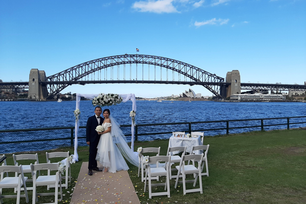 Couple getting married by Sydney harbour